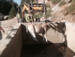 Vaca salvada del pilón
